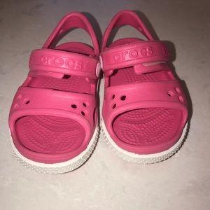 Toddler girl pink CROCS sandals, size 5.